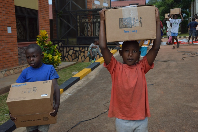 UGANDA: Children at Don Bosco Children and Life Mission Receive Donation of Rice-Meals from Feed My Starving Children